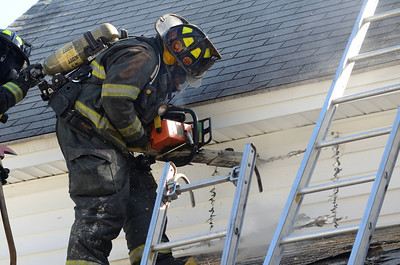 An Orange, Mass FF vents the side of the building above the fire while operating at a 2nd Alm fire on Burrill Ave. One dog was rescued from the house. 3 towns responded Mutual Aid to the fire.