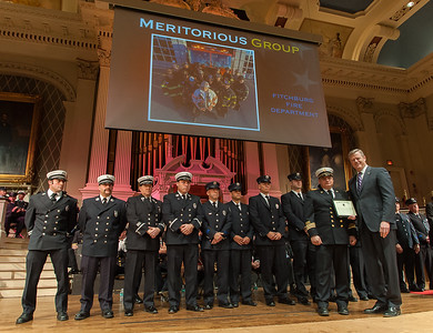 Deputy Chief Dave Gravel accepts a Group Citation for Meritorious Conduct from Massachusetts  Governor Charlie Baker on behalf of his group for actions on February 10th at 176 Walton St. during the 27th Annual Massachusetts Firefighter of the Year Awards at Mechanics Hall in Worcester.