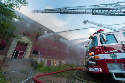 Water pours from the front door of the former BF Brown sdchool during the 4th Alm fire.