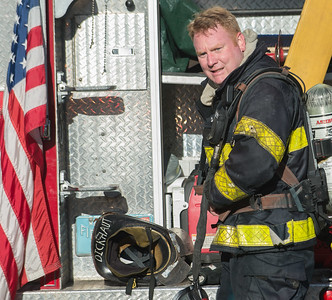 Fitchburg firefighter John Dickhaut comes out of the builidng after a Working Fire on Cottage St.