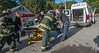 Fitchburg firefighters and MedStar EMS rush a victim of a Cottage St house fire to a waiting ambulance.
