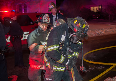 FF Matt Glenny (right) gets his air bottle changed by Safety Officer Lt Richard Liberatore at a 2nd Alm fire at 176 Walton St.
