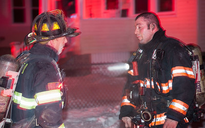 FF Patrick Haverty (left) confers with Capt Anthony Marrama at a double fatal 2nd Alm at 176-178 Walton St.