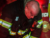 An exhausted FF Tim O'kane takes a breather after assisting in locating a victim of the 2nd Alm fire on Walton St.