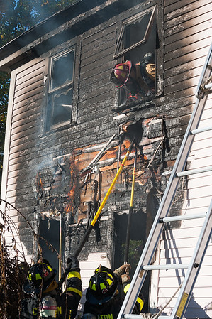 LANCASTER - Firefighters from Clinton, Devens and West Boylston work overhauling an old farmhouse at 325 George Hill Rd during a 3rd Alarm fire. [Photo/JIm Marabello]