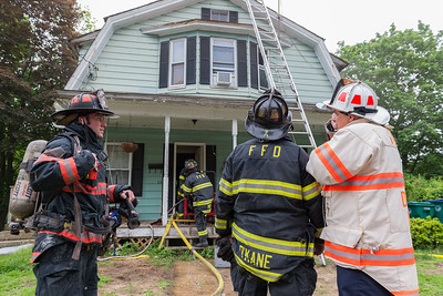 Fitchburg Deputy Fire Chief Dave Gravel (right) directs crews during a fire at 87 Roosevelt St.