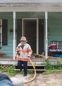 Fitchburg Deputy Fire Chief Dave Gravel exits the building at 87 Roosevelt St after a fire in the basement.