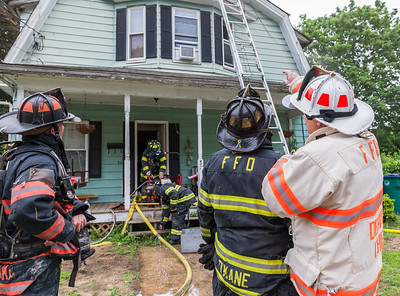 Fitchburg Deputy Fire Chief Dave Gravel directs crews during a fire at 87 Roosevelt St.