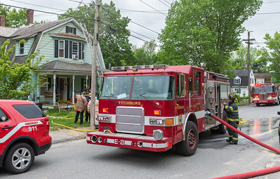 Fitchburg Crews mop up at 87 Roosevelt St in Fitchburg after a fire in the basement.