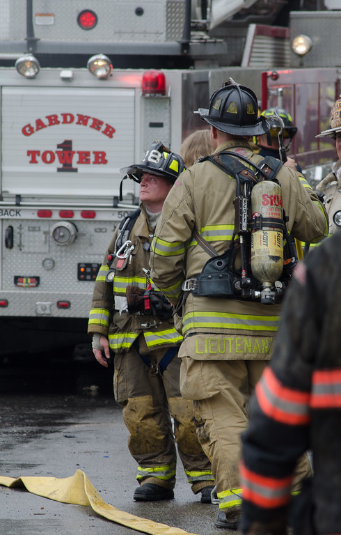 Sterling FF Jamie Shea looks over the ongoing operations at a 6 Alm fire in Gardner on Sherman St.