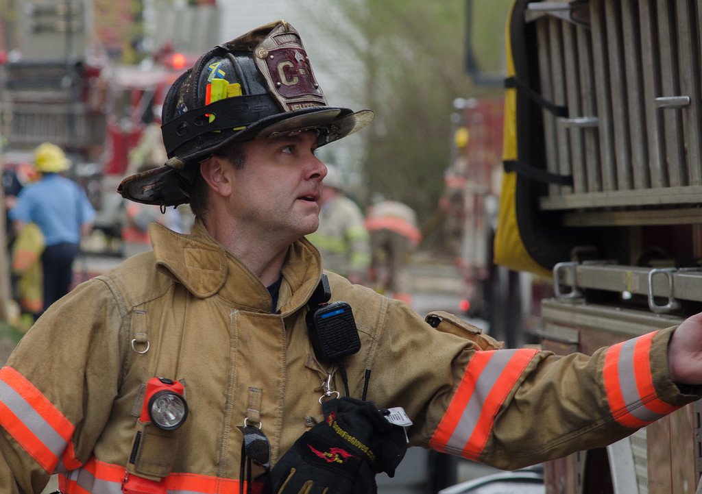 Lunenburg Lt Scott Dillon grabs for an axe during a 6 Alm fire on Sherman St in Gardner.