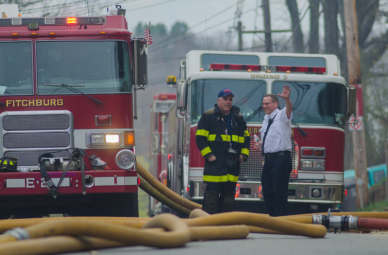 Fitchburg FF Scott Peralta chats with Leominster Fire Chief Rob Sideleau at a 6th Alm on Sherman St in Gardner.