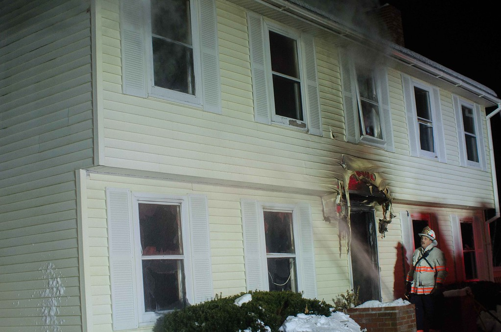 Fire Chief Kevin Nivala observes 2nd floor operations on Hy Rd.