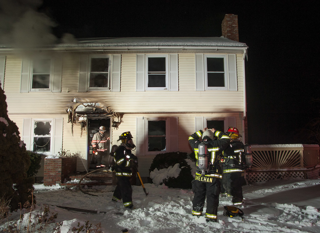 FFs prepare to enter a house Hy Rd at a 2nd Alm