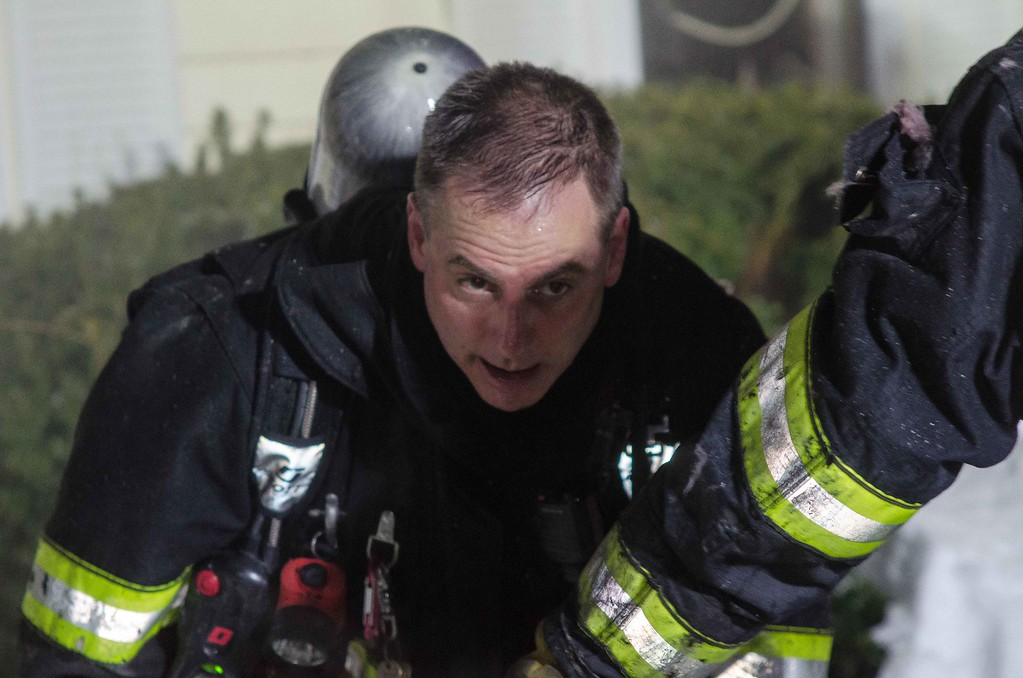 Westminster FF Phil d'Entremont exits the building after knocking down a 2nd Alm fire on Hy Rd.