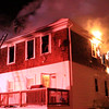 Fitchburg crews work the roof during a two-alarm fire on Walton Street in Fitchburg early Wednesday morning. SENTINEL & ENTERPRISE / Scott LaPrade