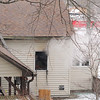 Smoke could be seen at 21 Normal Road in Fitchburg on Tuesday. Firefighter work to put out out the fire. SENTINEL & ENTERPRISE/JOHN LOVE