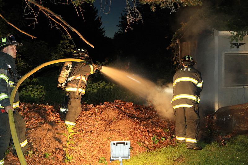 Fitchburg Firefighters put water on the fire that is outside the shed<br /> <br /> Photo Scott LaPrade