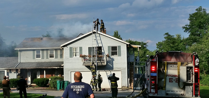 Fitchburg firefighters work to contain a blaze in a house at 513 Williams Rd on Saturday afternoon. The rural location necessitated calling several towns Mutual Aid for tankers. SENTINEL&ENTERPRISE / David Bryce