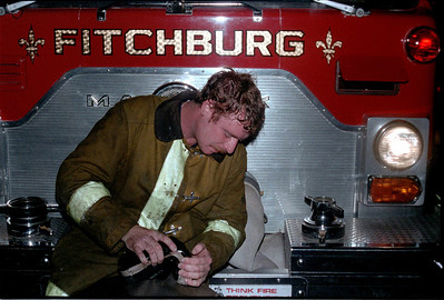 August 1st, 1982. Middle & 1st Sts, multiple Alm fire. Jimmy Roy empties a boot before going back in the building.