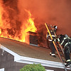 Leominster Firefighters getting off the roof on Granite St