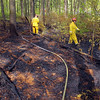 A brush fire broke out at the Notown Reservoir in Leominster on Wednesday afternoon. SENTINEL & ENTERPRISE/JOHN LOVE