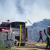 Crews from Shirley, Lancaster, Devens, Lunenburg, Leominster, Fitchburg and Groton battled a large mulch fire at Mad Mics Organics in Shirley on Friday afternoon. SENTINEL & ENTERPRISE / Ashley Green