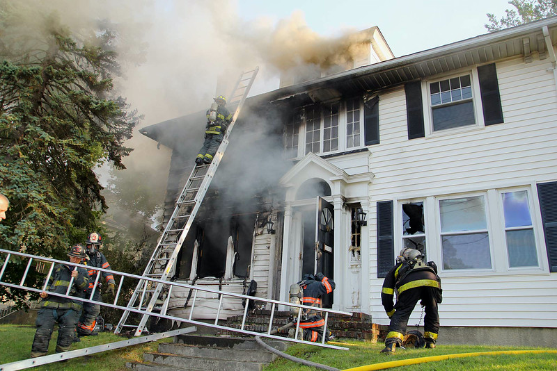 A fire broke out at 301 Pratt Street in Fitchburg on Friday afternoon. SENTINEL & ENTERPRISE/JOHN LOVE