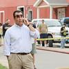Gardner's Mayor Mark Hawke talks on his cell phone as he watchs the fire on Sherman Street where an abandoned furniture warehouse burnt down.  SENTINEL & ENTERPRISE/ JOHN LOVE