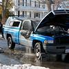A Dodge Ram 1500 caught fire in front of 278 Walton Street in Fitchburg on Thursday morning. SENTINEL & ENTERPRISE/JOHN LOVE