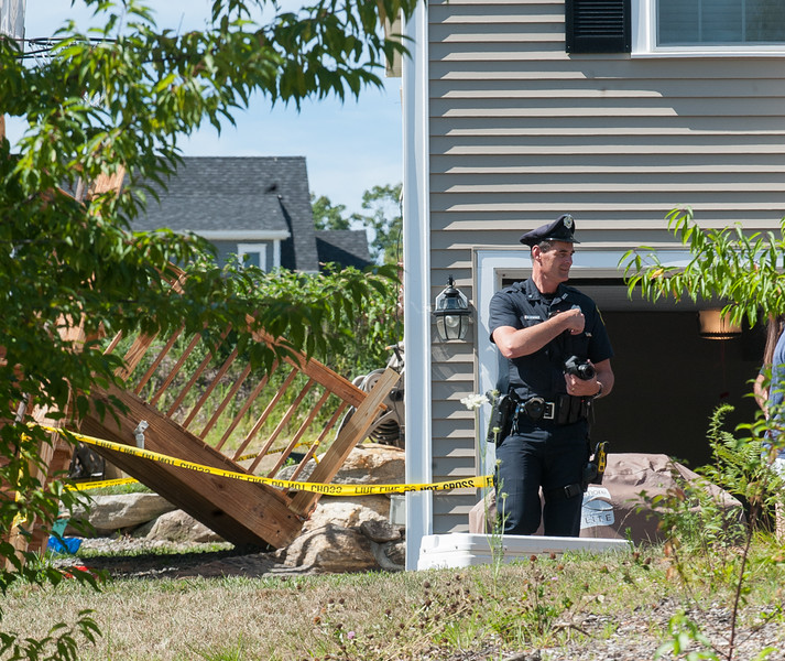 A Westinster Police officer investigates a deck that collapsed on Rebanna Drive. 6 people were reportedly on the deck and 1 was transported to the hospital. SENTINEL&ENTERPRISE/ Jim Marabello