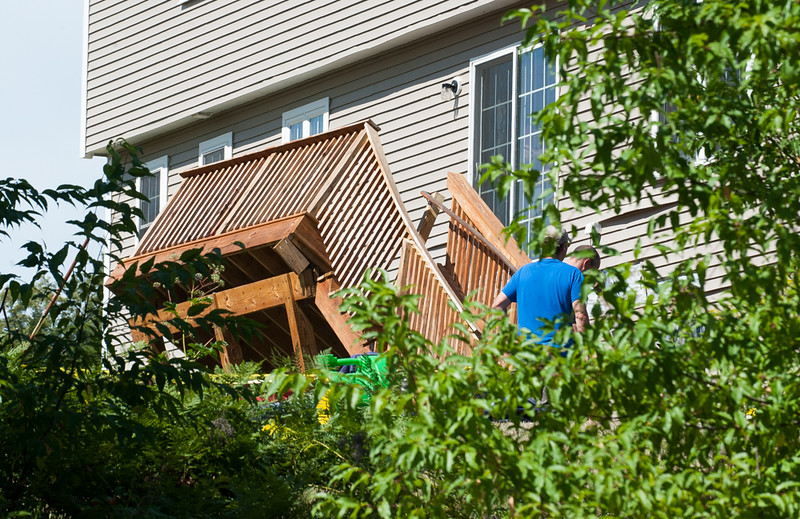A deck leans in a precarious positions after it seperated from its Rebanna Dr house and collapsed. 6 people were reportedly on the deck with 1 being transported to the hospital. SENTINEL&ENTERPRISE/ Jim Marabello