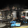 Firefighters have the fire knocked down at the rear of Joyces Pies<br /> <br /> Photo  Scott LaPrade