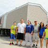 Robert Yang, second from left stands with some of his family outside the trailer he got for them to live in as their home in Fitchburg is fixed after a fire. With him from left is his son Sky Yank, 12, his sister Lia Yang, 19, his dad Herpao Yang, his daughters Anastasia Yang, 11, and Nevaeh Yang, 10.  SENTINEL & ENTERPRISE/JOHN LOVE