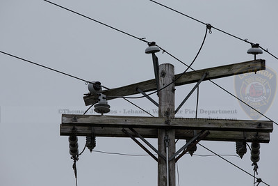 Broken insulator on one phase of the power distribution lines, causing the conductor to come in contact with the cross arm