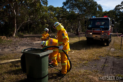 Mittagong Brigade competing in the Tanker and Pump event, utilising portable pumps, McLeod tools and Knapsacks.