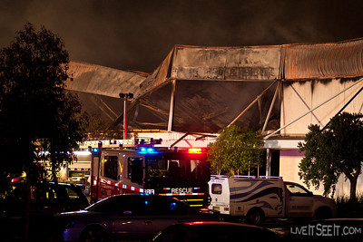 The roof is twisted and partially collapsed