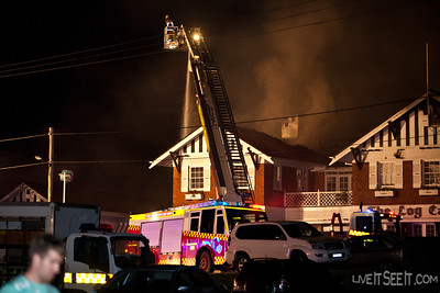Ladder Platform 27 Parramatta at work on the Log Cabin Fire in Penrith with P98 Cranebrook supplying water