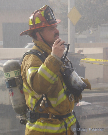 A Burbank Fire Captian gives an update on the radio at the scene of an explosion and fire in Burbank.