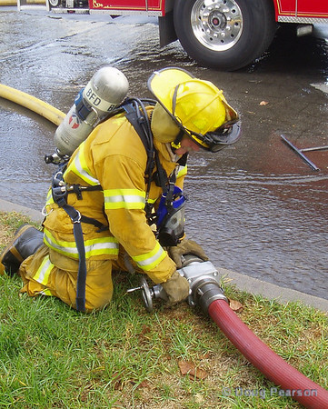 A Burbank firefighter is adjusting the water supply for a master stream at an explosion and fire in Burabank..