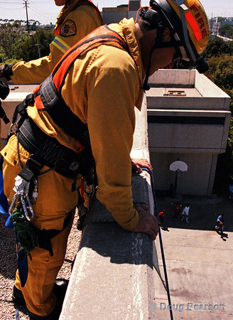 Checking the rappel.  LA County Fire Department USAR rappelling demo at Fire Service Day 2004