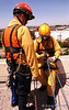 Final check of the lines.  LA County Fire Department USAR rappelling demo at Fire Service Day 2004