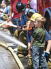 Explorers demonstrated how to use the fire hose for the children, LA County Fire Department Fires Service Day at Fire Station 129 on May 3, 2008