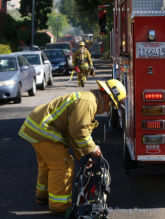 Engineer from LAFD Engine 27 getting ready to go in to the fire.
