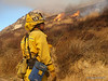 A firefighter watches for flareups along the nothwest flank of the Sayre Fire.