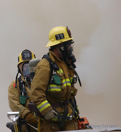 LAFD Engine 39 crew members checking the roof.