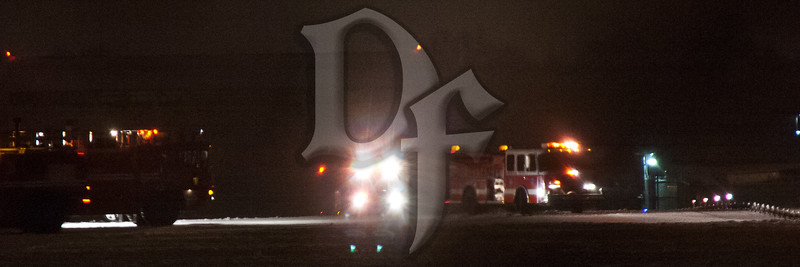 Fire trucks from the Rochester Airport (ROC) Fire Department remain on scene as Rochester FD Engine 7 (right) prepares to leave after assisting in the evacuation of passengers from United flight 3350 from Chicago. The ERJ-145 was unable to stop after landing and slid into the runway 4 safety area just before midnight on February 22, 2012. At the right of the picture are the threshold lights marking the end of the runway.
