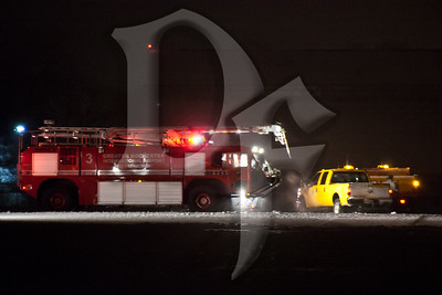 Rochester Airport FD Rescue 3 on the scene of an aircraft overrun incident at the Greater Rochester International Airport. The incident occurred just before midnight on February 22, 2012.