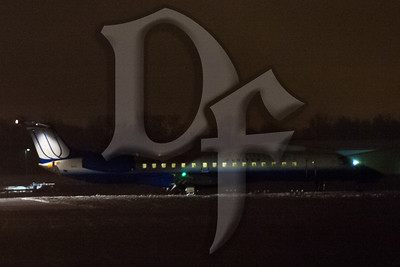 United Airlines flight #3350, an ERJ-145, sits just off the end of the runway 4 at the Greater Rochester International Airport (KROC). Just before midnight on February 22, 2012, the aircraft arrived from Chicago but was unable to stop before going into the overrun safety area.