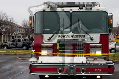 North Greece FD Engine 273 remains at the scene of a vehicle fire while awaiting the arrival of a Fire Investigator. 2011, December 22